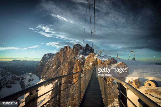 austria, styria, schladming, swinging bridge at dachstein - schladming stock pictures, royalty-free photos & images