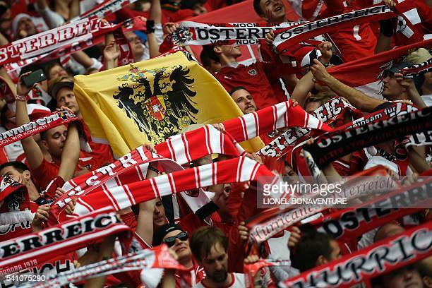 Austria supporters cheer prior to the Euro 2016 group F football match between Portugal and Austria at the Parc des Princes in Paris on June 18,...