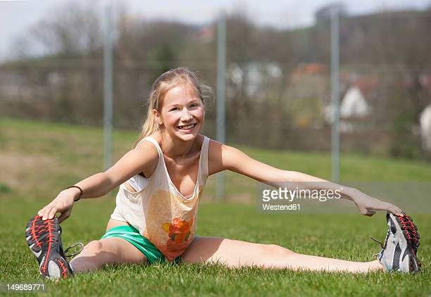 austria, teenage girl doing gymnastics, smiling, portrait - girl with legs spread stock photos and pictures