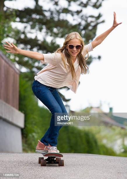 Austria, Teenage girl doing skateboarding