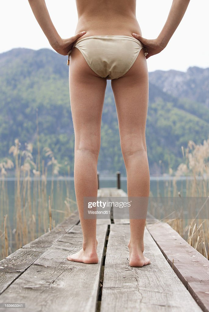 Austria, Teenage girl standing on jetty : Foto stock