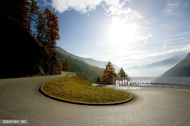 austria, timmelsjoch, curve on mountain road - hairpin curve stock photos and pictures