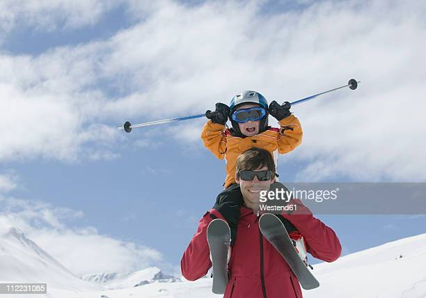Austria, Tirol, Father carrying son on his shoulders