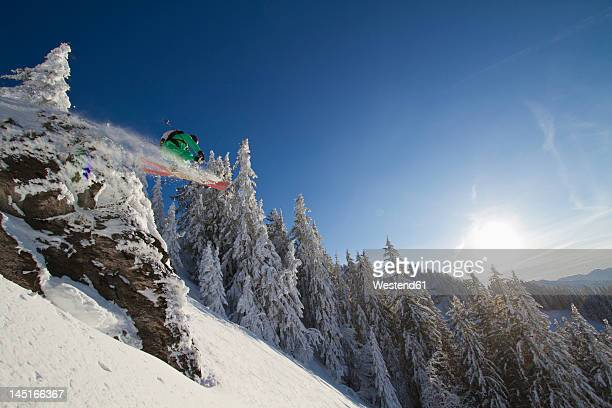 Austria, Tirol, Kitzbuehel, Man doing ski jumping