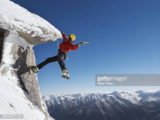 austria, tirol, mountaineer with ice pick ascending hintertux glacier - extreme sports stock pictures, royalty-free photos & images