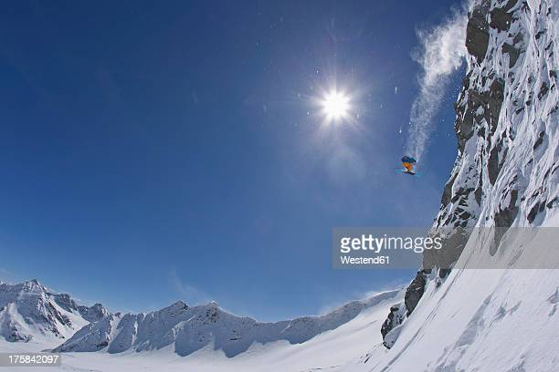 austria, tirol, young man doing freeride skiing - ski jumping stock pictures, royalty-free photos & images