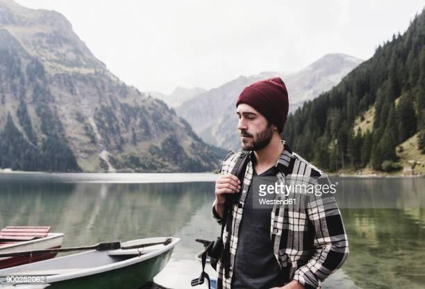 austria, tyrol, alps, serious man at mountain lake - checked shirt stock photos and pictures
