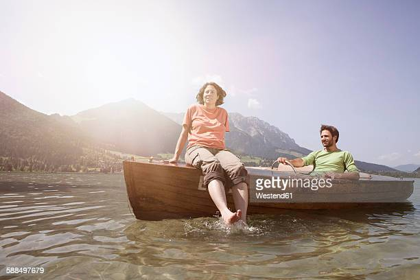Austria, Tyrol, couple driving with boat on Walchsee