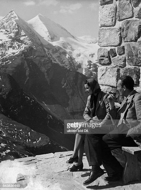 Austria Tyrol Couple in front of the mountains of the grossglockner peak Photographer Max Ehlert Published by 'Hier Berlin' 17/1938Vintage property...