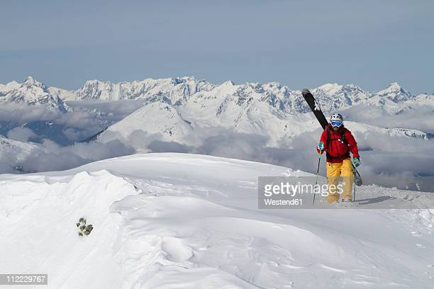 Austria, Tyrol, Gerlos, Man skiing on snow covered mountain