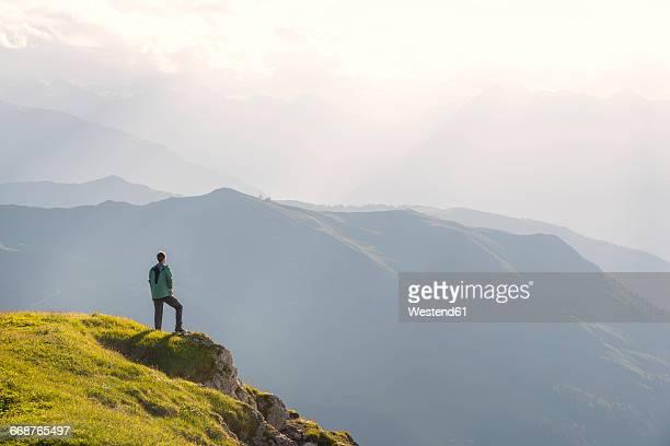 Austria, Tyrol, hiker looking at distance