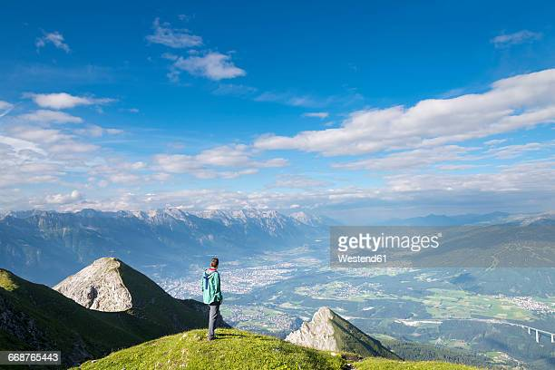 Austria, Tyrol, hiker looking to Innsbruck