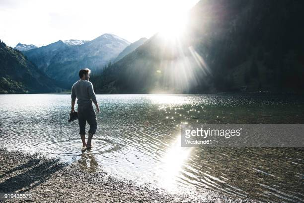 austria, tyrol, hiker refreshing in mountain lake - wading stock pictures, royalty-free photos & images