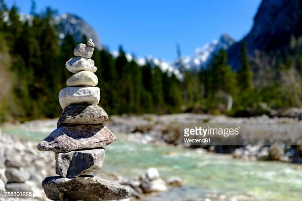 Austria, Tyrol, Hinterautal, cairn at Isar River