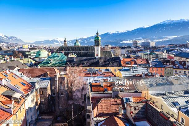 austria, tyrol, innsbruck, panoramic views of the city with snow-capped alps in background - innsbruck stock pictures, royalty-free photos & images