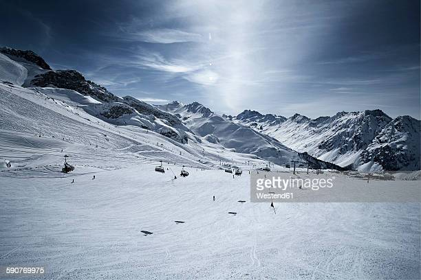 Austria, Tyrol, Ischgl, chair lift in winter landscape in the mountains