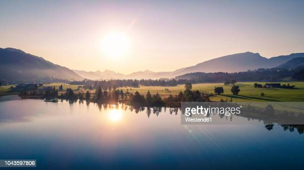 austria, tyrol, kaiserwinkl, aerial view of lake walchsee at sunrise - austria stock pictures, royalty-free photos & images