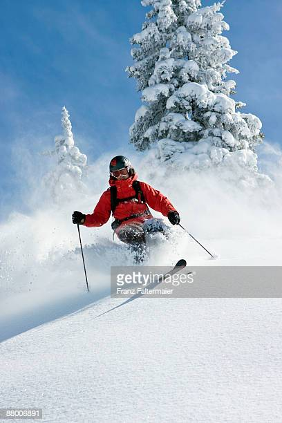 austria, tyrol, kitzbühel, pass thurn, freeride, man skiing downhill - powder snow stock pictures, royalty-free photos & images