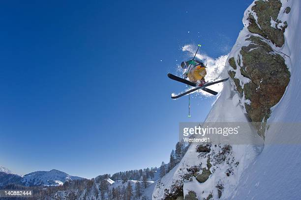 Austria, Tyrol, Kitzbuehel, Mature man doing freestyle skiing