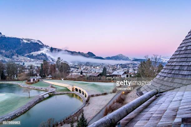 austria, tyrol, kitzbuehel, view to the city at morning twilight - kitzbuehel stock-fotos und bilder
