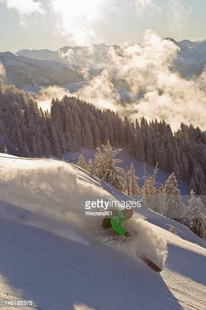 austria, tyrol, kitzbuhel, mid adult man skiing - kitzbühel stock pictures, royalty-free photos & images
