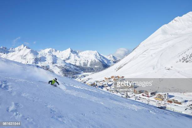 Austria, Tyrol, Kuehtai, man skiing in winter landscape