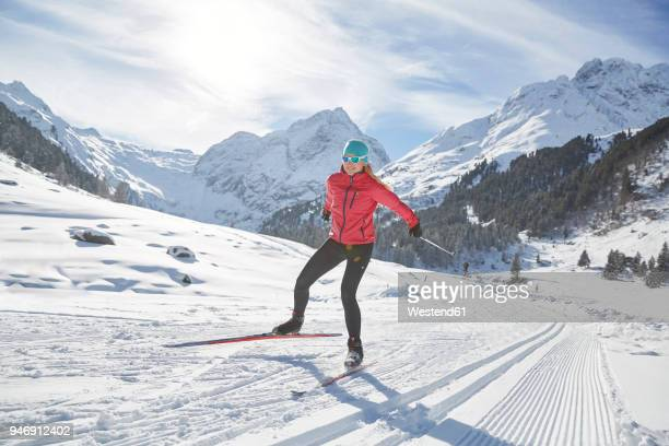 austria, tyrol, luesens, sellrain, cross-country skier in snow-covered landscape - langlaufen stockfoto's en -beelden
