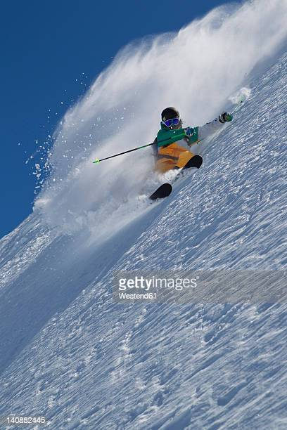 Austria, Tyrol, Pitztal, Mature man doing freestyle skiing