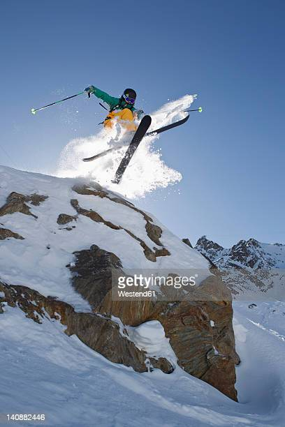 austria, tyrol, pitztal, mature man doing freestyle skiing - ski jumping stock pictures, royalty-free photos & images
