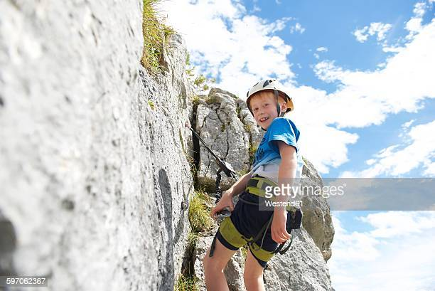 Austria, Tyrol, Rofan mountains, young boy climbing