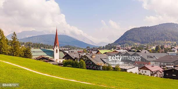 austria, tyrol, seefeld in tirol, townscape with parish church st. oswald - ゼーフェルト ストックフォトと画像