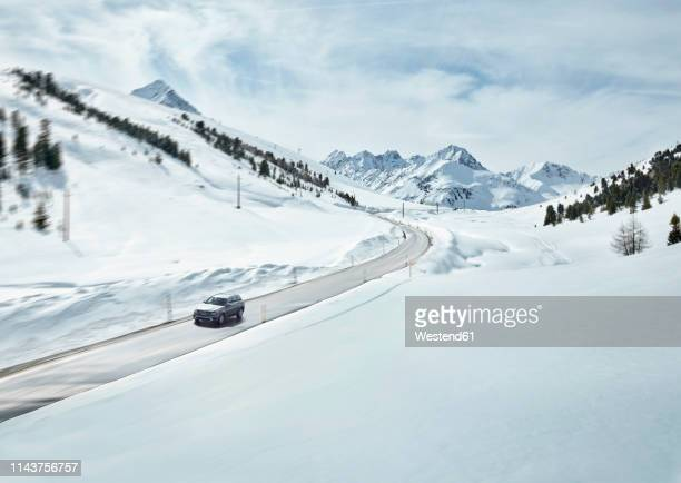 austria, tyrol, sellrain valley, kuehtai, car on mountain road in winter - mountain pass stock pictures, royalty-free photos & images
