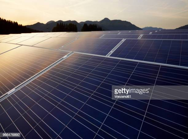 Austria, Tyrol, solar plant at evening twilight