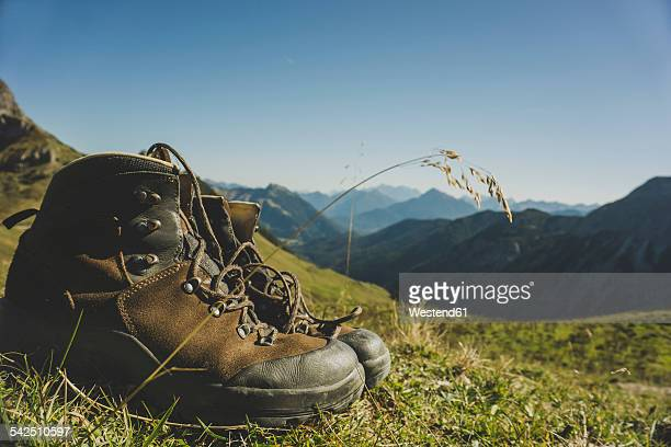 Austria, Tyrol, Tannheimer Tal, hiking boots in mountainscape