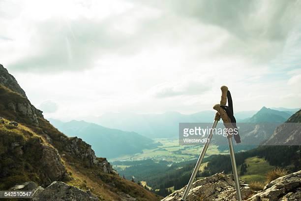 Austria, Tyrol, Tannheimer Tal, hiking poles in mountainscape