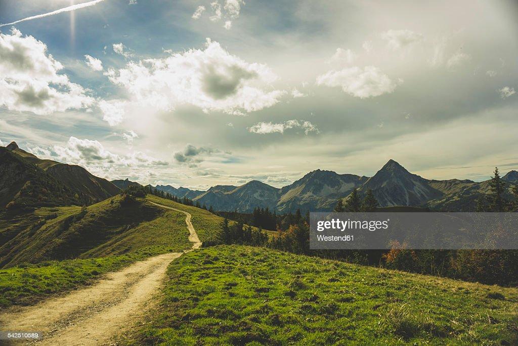 Austria, Tyrol, Tannheimer Tal, hiking trail in mountainscape : Stock Photo