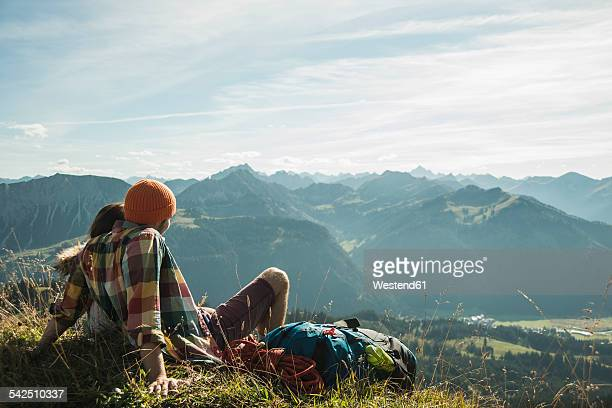 Austria, Tyrol, Tannheimer Tal, young couple having a rest in the mountains