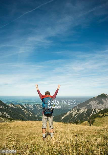 Austria, Tyrol, Tannheimer Tal, young couple hiking