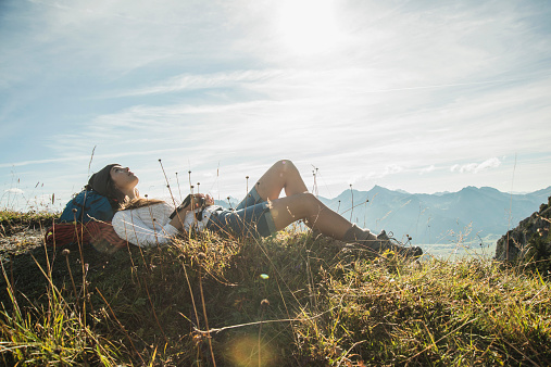 Austria, Tyrol, Tannheimer Tal, young hiker having a rest - gettyimageskorea