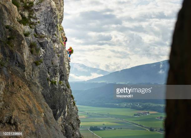 austria, tyrol, two rock climbers in martinswand - free climbing stock pictures, royalty-free photos & images