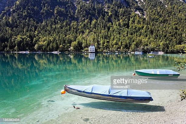Austria, Tyrol, View of boat by lake plansee near reutte