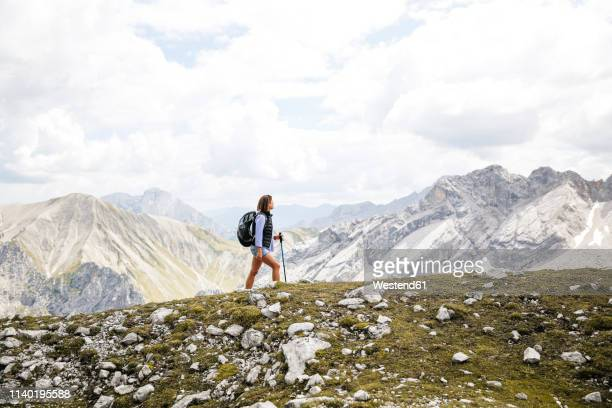 austria, tyrol, woman on a hiking trip in the mountains - bavarian alps stock pictures, royalty-free photos & images