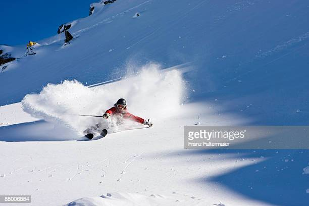 Austria, Tyrol, Zillertal, Gerlos, freeride, man skiing downhill, low angle view