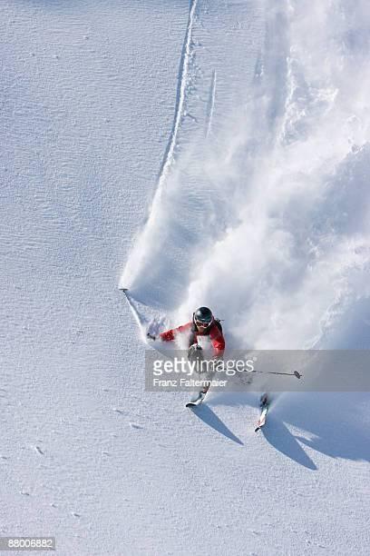Austria, Tyrol, Zillertal, Gerlos, freeride, man skiing downhill, elevated view