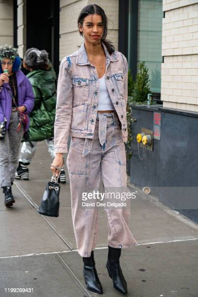 Austria Ullla wears a top by Joke denim outfit by Iceberg and Shoes by BCBG to NYFW at Spring Studios on February 7, 2020 in New York City.