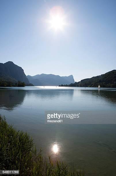 Austria, Upper Austria, Lake Mondsee, View to Drachenwand against the sun