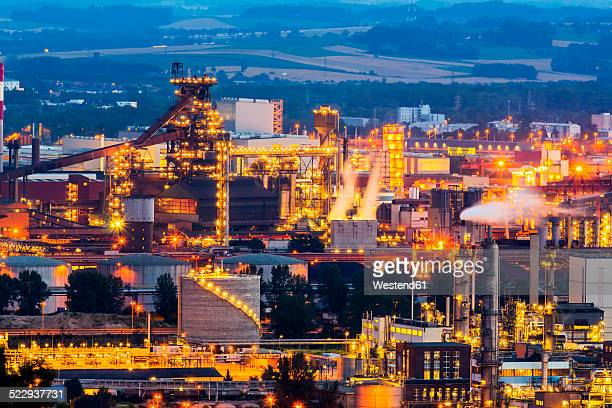 austria, upper austria, linz, industrial area in the evening - linz stock pictures, royalty-free photos & images