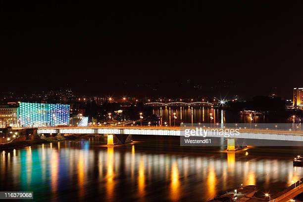 austria, upper austria, linz, view of ars electronica center with nibelungenbrücke at night - linz stock pictures, royalty-free photos & images
