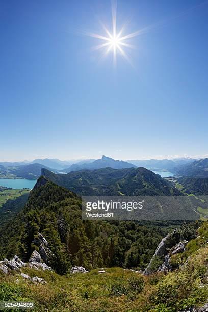 Austria, Upper Austria, Salzburg State, Salzkammergut, View to Lake Mondsee left, Drachenwand, Schafberg and Lake Wolfgangsee against the sun