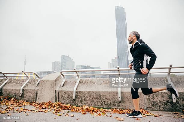 Austria, Vienna, athlete running on Donauinsel